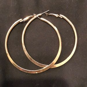 Large gold hoop earring